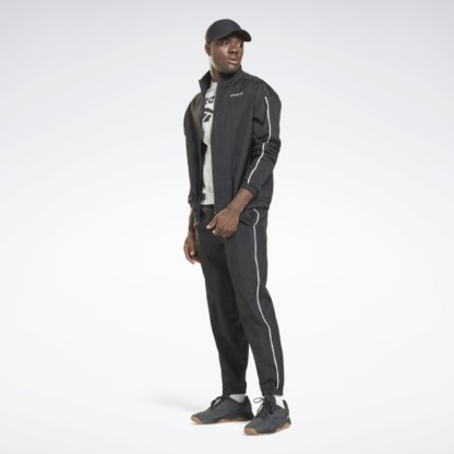 Rock this men's Reebok track suit on your day off, and bring your sporty style to the street. If the weather turns wild, the durable, water-repellent fabric gives you time to find shelter before you get soaked. Contrast piping on the jacket and pants adds a pop of style.